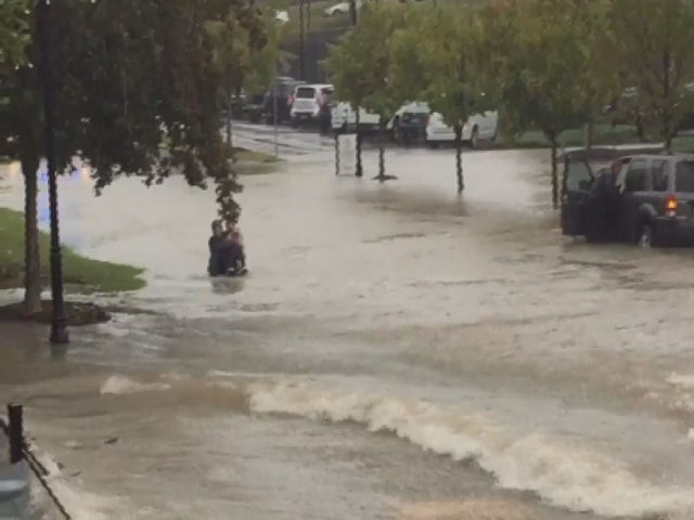 USC Police rescue a driver trapped by floodwaters on campus Thursday. (Courtesy of Jarrett Ritter)_48280