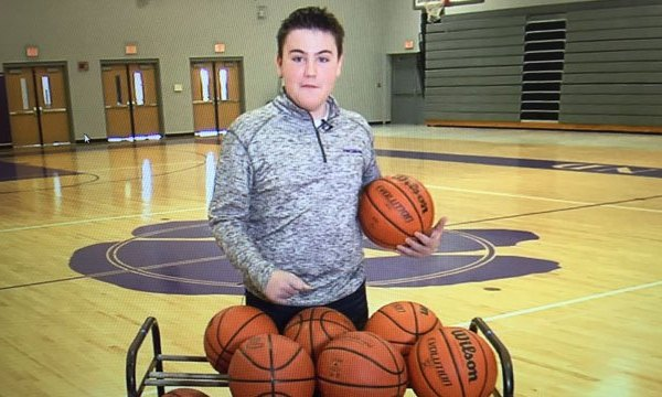 Autistic student Anthony Brown scores in basketball game._82345