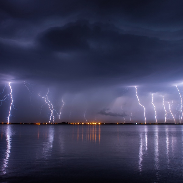 Thunderstorm and lightnings in night over a lake with reflaction_295056