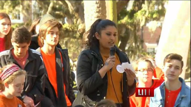student walk out Savannah Arts Academy_379479