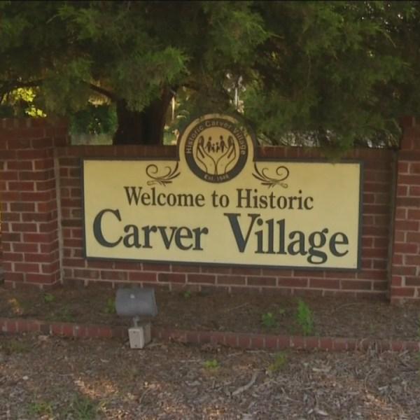 Community reacts to Historic Carver Village gang arrests.