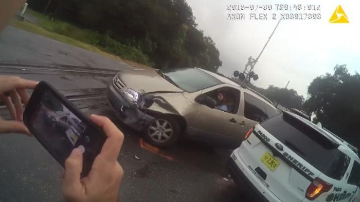 Close call: Car crash leads to train wreck