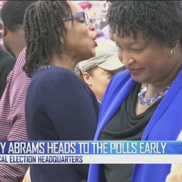 Abrams heads to the polls early