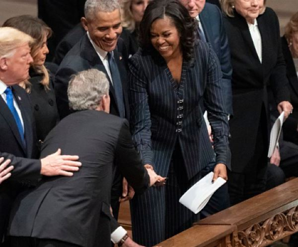 George W. Bush and Michelle Obama continue sweet tradition at his father's funeral
