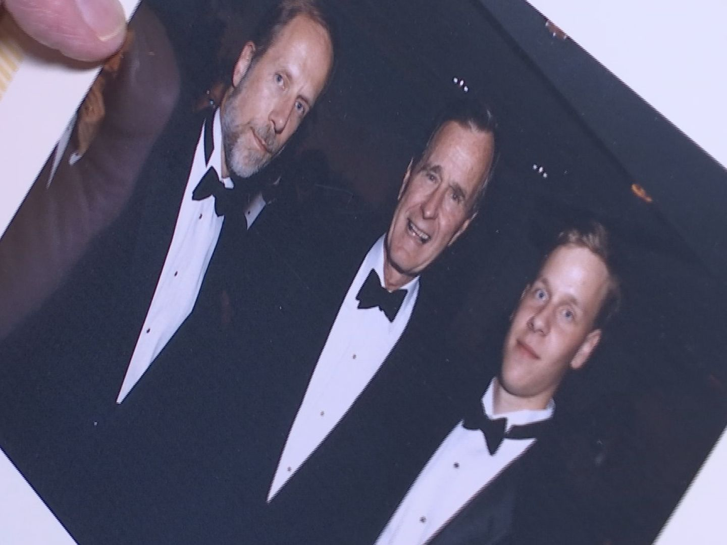 George H. W-846624087. Bush pictured with Charles Bierbauer and son