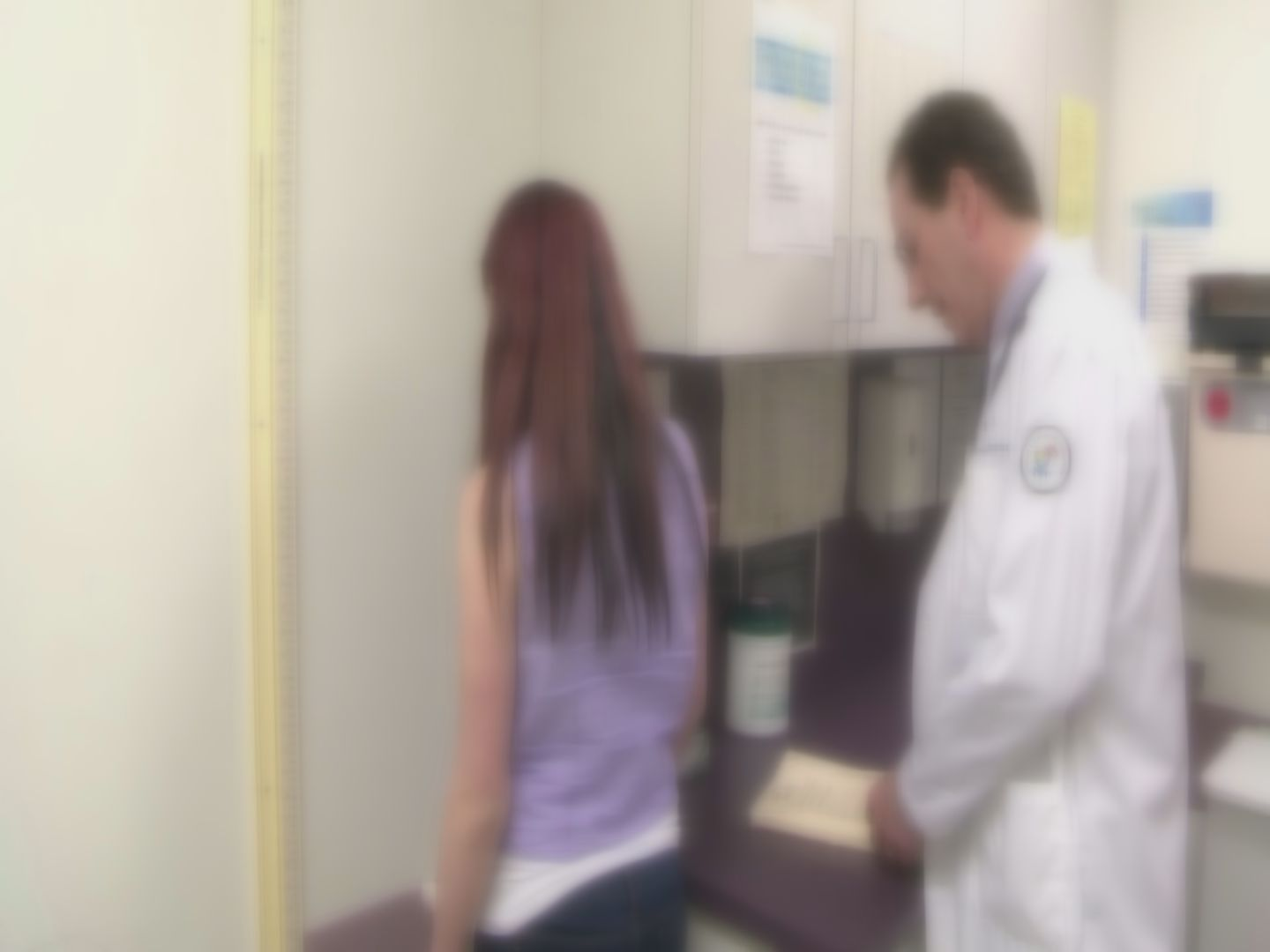 Teenage girl at doctor-846624087