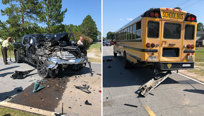 Driver taken to hospital following school bus crash in