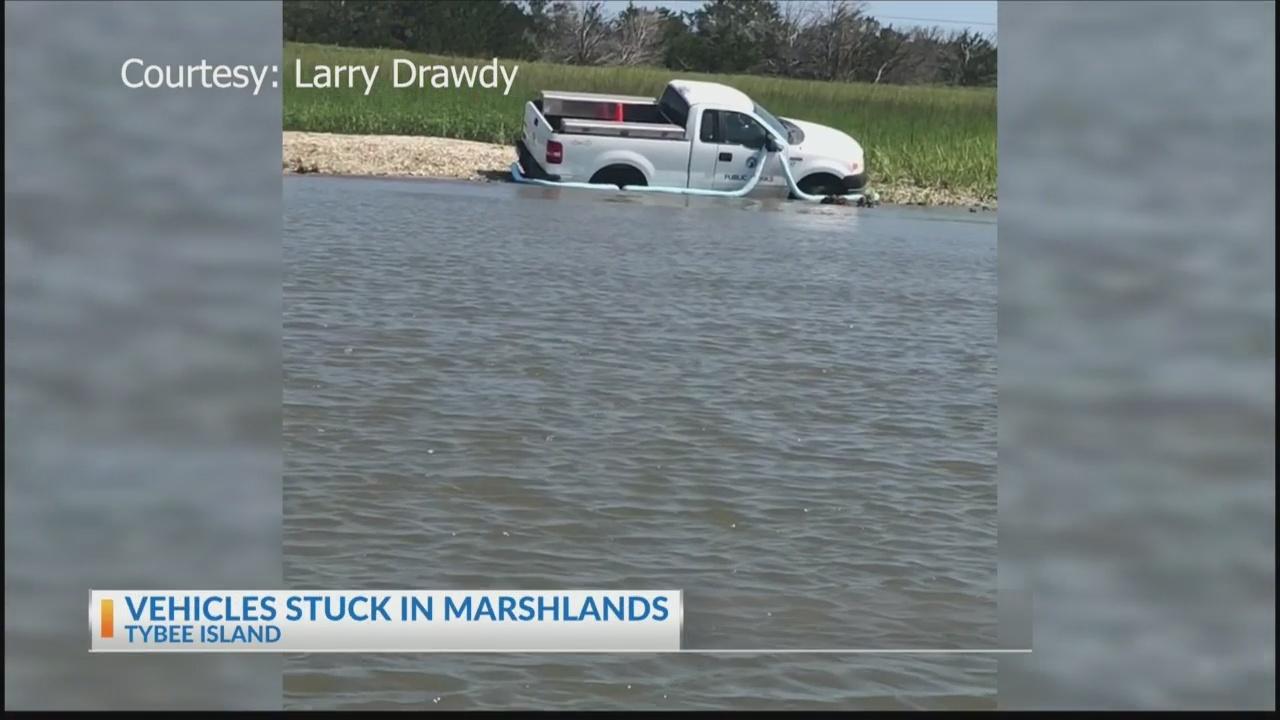 Vehicles stuck in marsh on Tybee