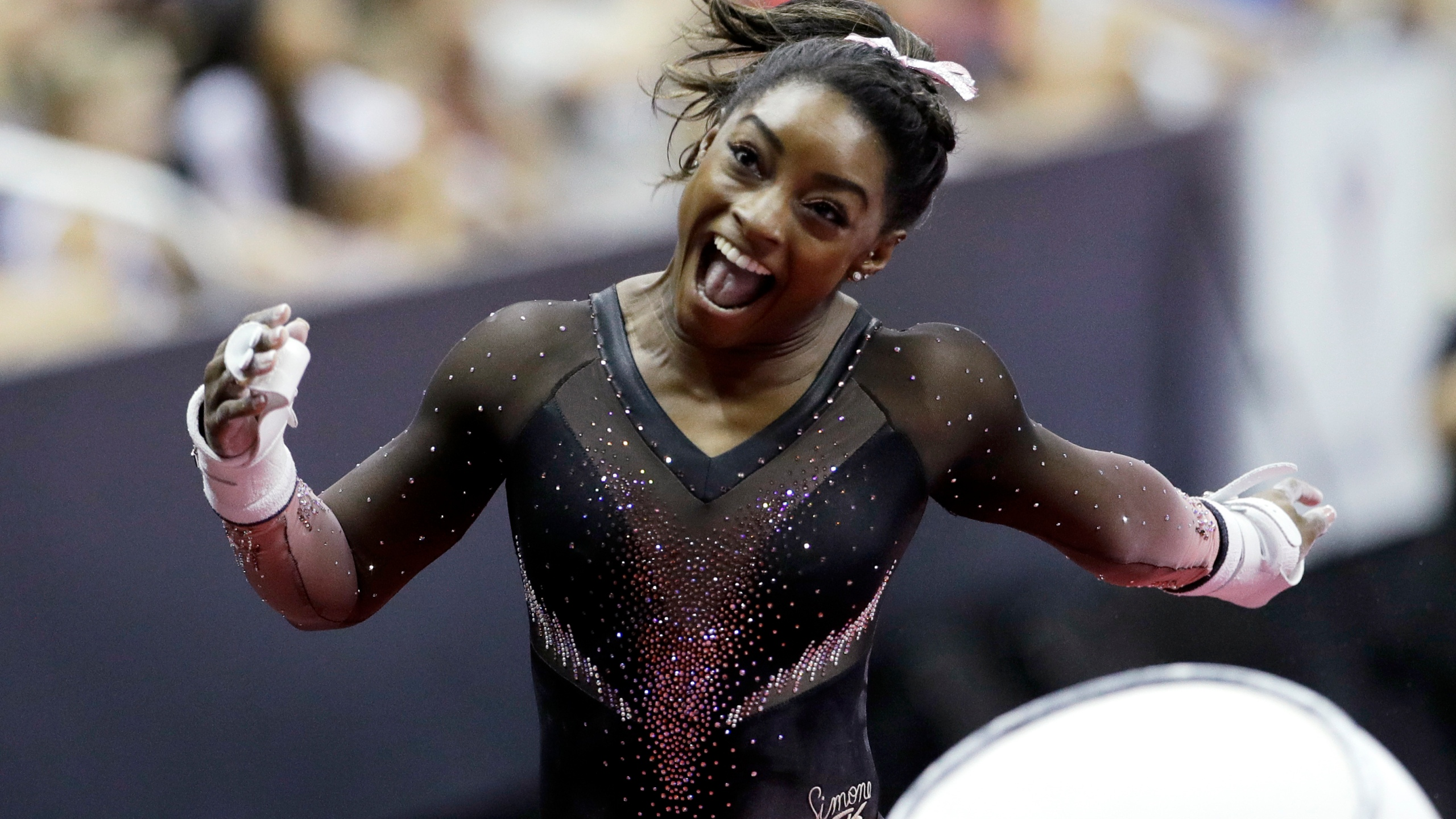 Simone Biles soars to 6th US gymnastics title, makes history with